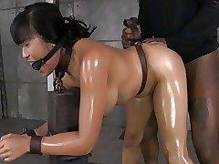 Oiled Asian confine with the..